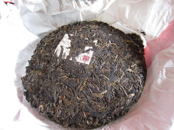 A cake of Yunnan Pu'er tea. In ancient times, tea was compressed into cakes or bricks for easier transport over the long journey to Tibet. Just break off a piece, brew and drink!