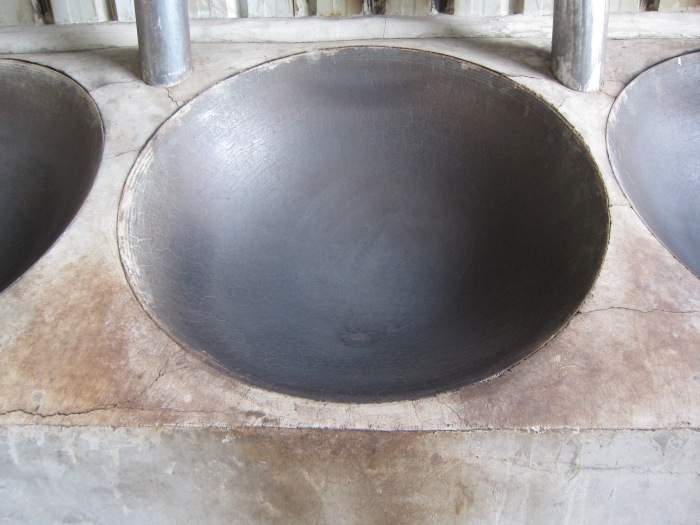 Then they are fried in big woks to stop the oxidation process.