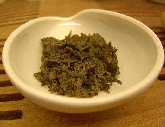 Tea leaves, Wu Liang Shan Sheng Puerh, at Tea Drunk. Owner Shunan Teng sources small batches of famous Chinese teas and her staff serves them Gong Fu style.