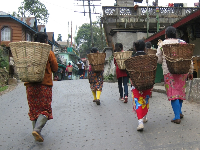 Tea pluckers returning home after a long day's work.