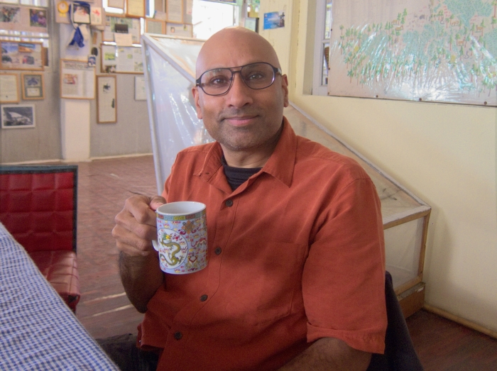 Having a cup of tea while waiting for Mr. Banerjee to join us.