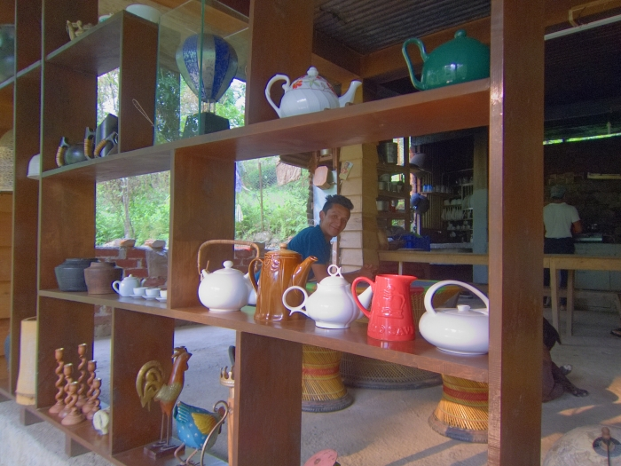 Restaurant at Tathagata Farm. My homestay host, Passang, is peering through from behind the shelves.